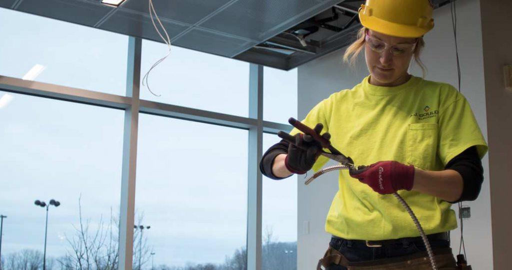 Electrician cutting wiring sheathing